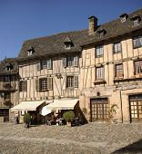 Conques, France - Sep 23 - Midday Diners Eat Under The Awning Of A Half-timbered House On Sep 23, 20