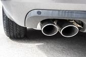 stock photo of carbon-dioxide  - exhaust pipe of a silver sporty car - JPG