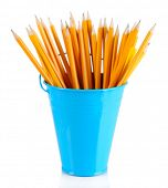 stock photo of non-permanent  - Colorful pencils and other art supplies in pail isolated on white - JPG