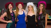 picture of hen party  - Smiling friends having hen party looking at camera - JPG