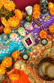 stock photo of day dead skull  - Traditional mexican Day of the dead altar with catrina sugar skulls cempasuchil flowers and candles - JPG