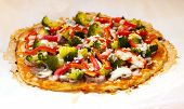 picture of pizza parlor  - Tasty roasted vegetable pizza for vegetarians on paper - JPG