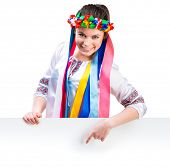 stock photo of national costume  - happy women  in the Ukrainian national costume behind white board with space for text - JPG