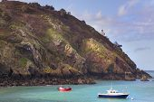 pic of sark  - Coastal scene on Sark with a  Lighthouse - JPG