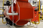 stock photo of boiler  - Industrial boiler room with red gas boilers - JPG