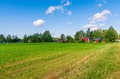 stock photo of barn house  - red houses in a rural landscape in Finland - JPG