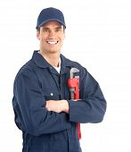 stock photo of plumber  - Young handsome plumber worker with adjustable wrench - JPG