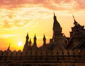 picture of religious  - Religious architecture and landmarks. Golden buddhist pagoda of Phra That Luang Temple under sunset sky. Vientiane Laos travel landscape and destinations