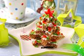 picture of chive  - christmas tree made from stack of star shape dark bread with cheese  - JPG