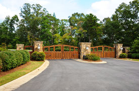 stock photo of gate  - Stately Security Gate at the Entrance of a Gated Community - JPG