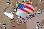 foto of camouflage  - US ARMY concept with dog tags on camouflage uniform - JPG
