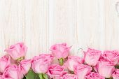 foto of white roses  - Valentines day background with pink roses over wooden table - JPG