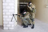 stock photo of ak 47  - insurgents with AK 47 and gun inside the building - JPG