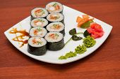 foto of crab  - sushi rolls with crabs meat at plate - JPG