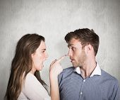 picture of argument  - Casual young couple in an argument against weathered surface - JPG