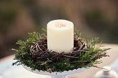 Постер, плакат: candlestick with burning candle in the nature