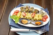 stock photo of carbonara  - Macaroni carbonara sauce and seafood served on a plate - JPG