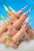 foto of nail-design  - Beauty spring floral design on women