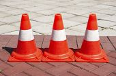 picture of traffic signal  - Three Signaling traffic cones on the paved path - JPG