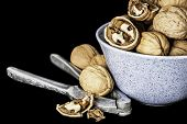 stock photo of nutcracker  - Nutcrackers and walnuts on a black background - JPG