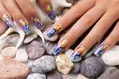 image of nail-design  - Female beauty hand with underwater sea nails design - JPG