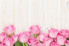 stock photo of valentine card  - Valentines day background with pink roses over wooden table - JPG