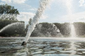 foto of gushing  - High pressured water gushing out of a pipe in a fountain