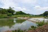 stock photo of collapse  - collapsing dam in the river in countryside of thailand - JPG