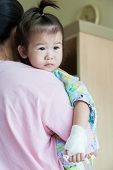 foto of intravenous  - Mother carrying her daughter illness child in hospital saline intravenous  - JPG