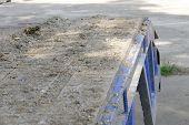 picture of dumper  - dirt on the old blue truck dumper for construction - JPG