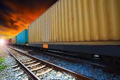 stock photo of train track  - boxcar container trains on track use for indutry land transportation