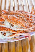 stock photo of crab  - crab seafood in thailand and bamboo table - JPG