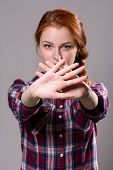 picture of stop fighting  - Out of focus woman with her hands signaling to stop isolated on a grey background - JPG