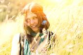 image of hippy  - Hippie girl in the meadow in a photograph with vintage artifacts deliberately to simulate vintage camera - JPG