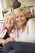 picture of visitation  - Adult Daughter Visiting Senior Mother Sitting On Sofa At Home - JPG