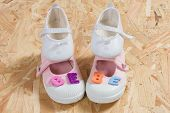 picture of born  - Baby card concept of new born baby with shoes - JPG