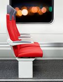 stock photo of passenger train  - red passenger chairs in a modern train - JPG