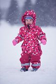 picture of snow-slide  - happy family on winter vacation - JPG
