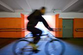 picture of underpass  - cyclist rides through the underpass or underground passage - JPG