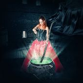 pic of witches cauldron  - halloween witch brewing a magic potion in an ancient pot and pours it sparkles - JPG