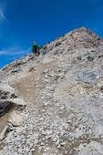 picture of ling  - looking up ha ling mountain in canada with lots of people on it and blue sky - JPG