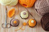 foto of thread-making  - Making of handmade colorful crochet toys sweets with skein on wooden table - JPG