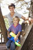 pic of tree house  - Teenage Boy And Brother Playing In Tree House Together - JPG