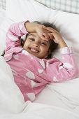 pic of pajamas  - Young Girl Wearing Pajamas Lying In Bed - JPG