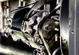 stock photo of lube  - Close up of transmission belt on car engine artistic image technique - JPG