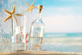 image of ouzo  - Traditional Greek ouzo at the beach - JPG