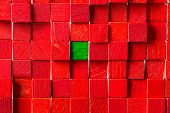 Wall Of Red Toy Blocks, Green Block In The Middle poster