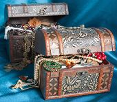stock photo of treasure chest  - Two wooden treasure chests with valuables on blue textile - JPG
