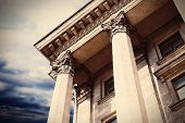 Courthouse facade with columns. Vintage style filter poster