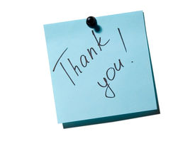foto of thank you note  - blue note paper with inscription thank you on the white board - JPG